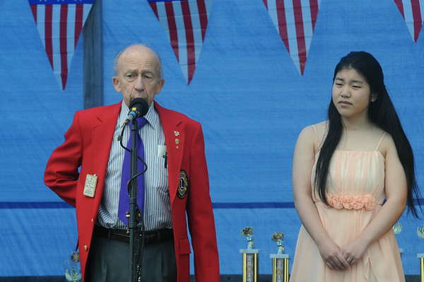 JIM VAIKNORAS/Staff photo Joseph Caouette of the Lions Club presents Michelle Lee of Seabrook a state wide award for a essay she wrote on Patriotism  at Seabrook Old Home Days Saturday at Seabrook Elementary School.