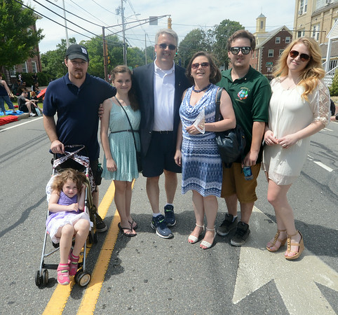 JIM VAIKNORAS/Staff photo Michael Valpone, center , and his family pose during the Yankee Homecoming Parade on High Street in Newburyport Sunday.