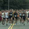 JIM VAIKNORAS/Staff photo Runners in the Lions Club Yankee Homecoming 5k take off on High Street in Newburyport.