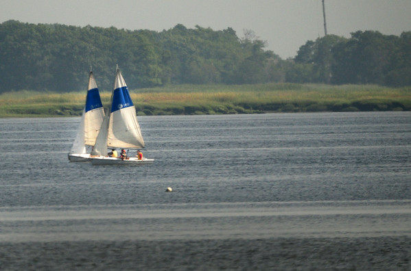BRYAN EATON/ Staff Photo. Youngsters taking sailboat lessons from the American Yacht Club catch the wind in the Merrimack River yesterday in a view from Water Street in Newburyport.