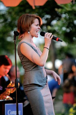 JIM VAIKNORAS/Staff photo Rebecca Holtz sings with the Compaq Big Band in Market Landing Park in Newburyport Saturday night.