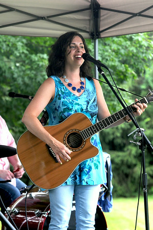 JIM VAIKNORAS/Staff photo  Stacey Peasley performs at Family Day at Maudslay in Newburyport Saturday.