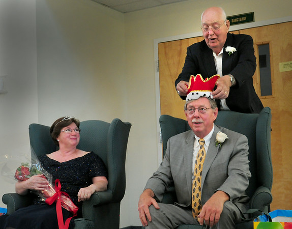 BRYAN EATON/ Staff Photo. Lon Hachmeister is crowned this year's Yankee Homecoming Senior King by last year's king Larry Quinn, Roseann Robillard having been crowned queen by Joyce Cejka, last year's queen.
