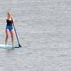 JIM VAIKNORAS/Staff photo A stand up paddle boardermakes her was along the waters off Plum Island Saturday afternoon.