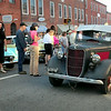 BRYAN EATON/Staff Photo. People watch as this old car and motorcycles parade up State Street.