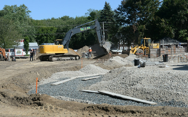 BRYAN EATON/Staff Photo. Forms are being put in place to pour concrete at the new Salisbury Public Library. The project is scheduled to take 18 months to complete once work started.