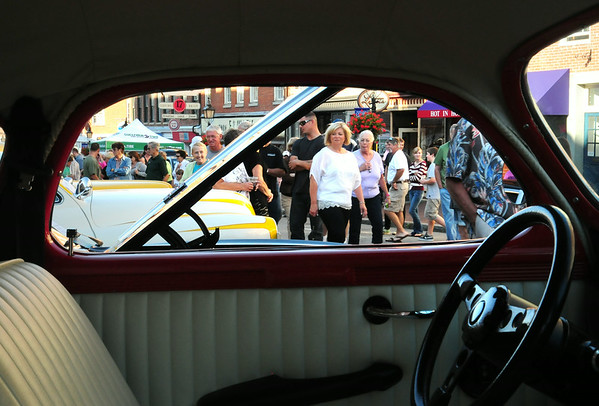BRYAN EATON/Staff Photo. Throngs of people came to the Newburyport Card Show as they have for the past two years, a crowd here seen through a 1939 Dodge DII coupe.