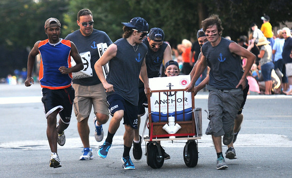 JIM VAIKNORAS/staff photo Anchor Pizza delivers a fast time at the Lions Club Bed Race on Federal Street in Newburyport.