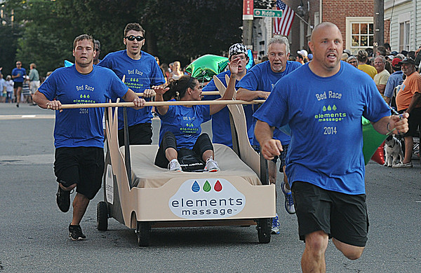 JIM VAIKNORAS/staff photo Elements Massage nears the finish line at the Lions Club Bed Race on Federal Street in Newburyport.