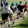 BRYAN EATON/Staff Photo. Pentucket football players go through drills yesterday for the first day of practice.