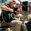 Newburyport: Jim Grenier, left, and Bob Brun of the Newburyport-based Stellwagen perform in Market Square yesterday. Bryan Eaton/Staff Photo