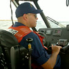 BRYAN EATON/ Staff Photo. Ruben Colon, BM2 in the US Coast Guard patrols the mouth of the Merrimack River.