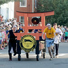 JIM VAIKNORAS/staff photo Tokyo Joe's race their bed at the Lions Club Bed Race on Federal Street in Newburyport.