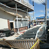 BRYAN EATON/Staff Photo. The underside of the deck at 18 Broadway, which houses several businesses including The Upper Deck, at Salisbury Beach collapsed apparently as rain seeped it from Wednesday's storm causing it to give way.