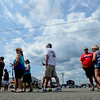 JIM VAIKNORAS/Staff photo The line grows for lobster and steamers at the Newburyport 250th Clam Bake at Plum Island point Sunday afternoon.