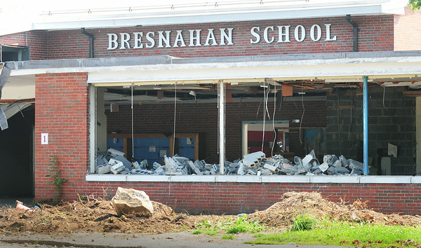 BRYAN EATON/ Staff Photo. The front entrance of the old Bresnahan School is filled with fallen cinder blocks.