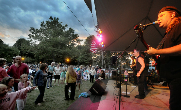 Newburyport:Crowd dance to the music of Beatlejuice as they performs in Market Landing Park at the Yankee Homecoming Waterfront Concert Series. JIm Vaiknoras/Staff photo