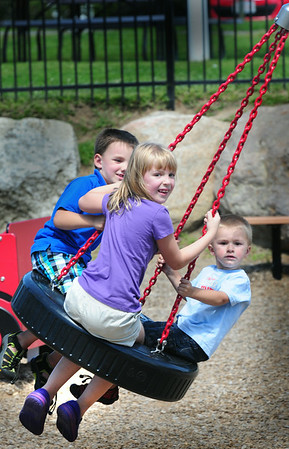 BRYAN EATON/ Staff Photo. Cousins meet halfway from home at the playground at Amesbury Town Park on Tuesday afternoon. Kaidyn Clough, 6, is from Haverhill and Logan Goudreau, 5, left and his brother Colby, 2, are from Seabrook and were there with their aunt Terri Clough.