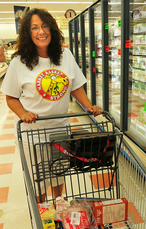 """BRYAN EATON/ Staff Photo. Paula Sargent of Merrimac wearing her """"Market Basket Strong"""" t-shirt returned to the Market Basket at Southgate Plaza where she said she'd been boycotting since day one. She participated at customer demonstrations outside that location and company headquarters in Tewksbury as well."""