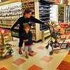 "BRYAN EATON/ Staff Photo. Candace Platt of Amesbury, with son Peter, 4, has two carts filled with food and supplies at the Market Basket at Southgate Plaza in Seabrook. She calls herself a ""stockpiler"" and had been boycotting along with many other customers."