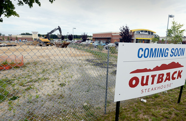 BRYAN EATON/ Staff Photo. An Outback Steakhouse is opening on Route One in Seabrook, part of many new developments near the intersection of Route 107.