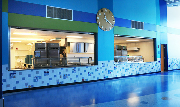 BRYAN EATON/ Staff Photo. A giant clock in the cafeteria hangs over the service area at the Bresnahan.