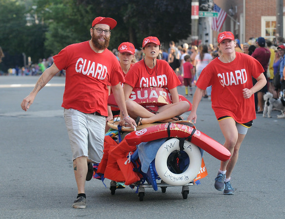 JIM VAIKNORAS/staff photo The lifeguards at the YWCA race to the finish at the Lions Club Bed Race on Federal Street in Newburyport.