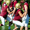 BRYAN EATON/Staff Photo. Newburyport High football team goes through defensive drills.