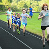 BRYAN EATON/Staff Photo. Youngsters run the 880 meter race at Amesbury High School track.