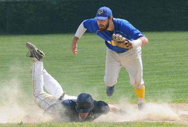 JIM VAIKNORAS/staff photo  Rowley Ram's second baseman Anthony Conti makes a play at second on a Manchester Essex player at Eiras Field in Rowley.
