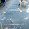 BRYAN EATON/ Staff Photo. Bodie Marcotte, 7, plays shuffleboard, coming in second place, at Amesbury Town Park during the town's summer camp. August 15 is the last day of the Amesbury Recreation Department's summer program.