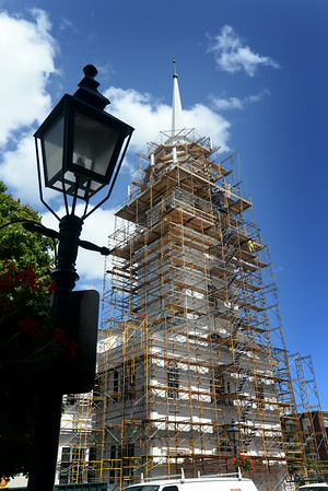 BRYAN EATON/ Staff Photo. Scaffolding envelopes the Unitarian Church on Pleasant Street in Newburyport as the historic structure is readied for repairs and painting.