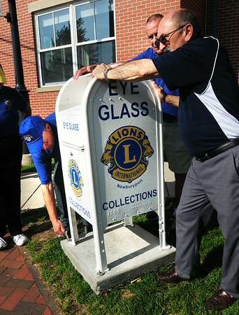 BRYAN EATON/ Staff Photo. Newburyport Lions Club members installed an eyeglass drop box, a mailbox donated by the US Post Office, in front of the Newburyport Public Library on Wednesday morning. Old glasses that are donated will be cleaned, scanned for optical prescription, repackaged and sent to people in need overseas.