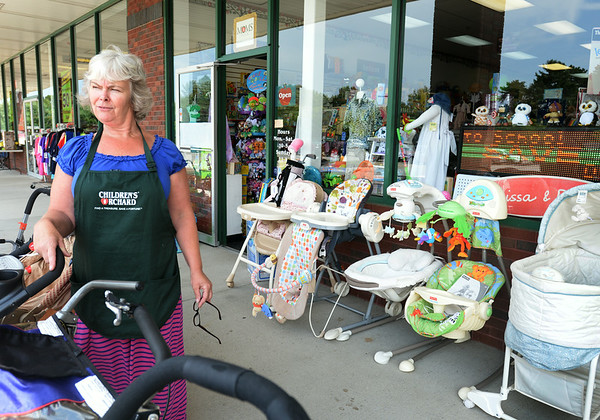 BRYAN EATON/ Staff Photo. Stephanie Johnson of the Children's Orchard in Rowley has seen business drop off since the Market Basket in the plaza has lost business as well.