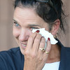 BRYAN EATON/ Staff Photo. Market Basket cashier Jacqueline Solazzo wipes  tears of joy as customers gave words of praise to the employees at the Newburyport location as they headed in to buy groceries.