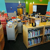 BRYAN EATON/ Staff Photo. The staff at the Bresnahan School library were organizing the shelves there yesterday.
