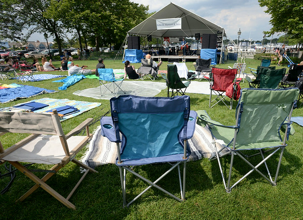 BRYAN EATON/ Staff Photo. Nearly half of Waterfront Park was covered with blankets and chairs by early afternoon as people staked out spots for last night's concert featuring Beatlejuice.
