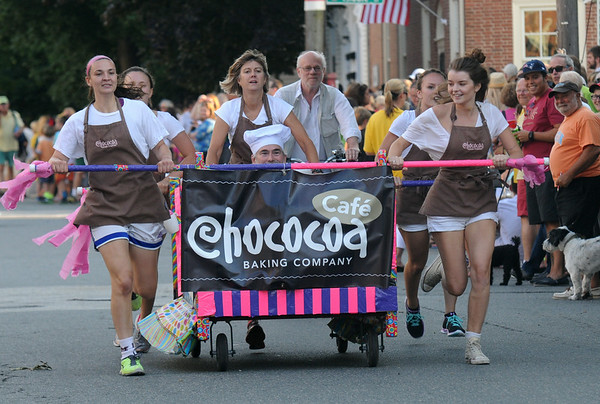 JIM VAIKNORAS/staff photo Chococoa Cafe screams to the finish line at the Lions Club Bed Race on Federal Street in Newburyport.