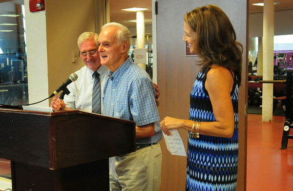 BRYAN EATON/ Staff Photo. Robert Welch, center, with emcee and friend Carl Beal, left, and his daughter Margaret, right, adresses the people in attendance for the naming of the fitness center at Newburyport High School after him.