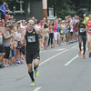 JIM VAIKNORAS/Staff photo Pat Fullerton wins the High Street Mile in Newburyport Sunday morning.