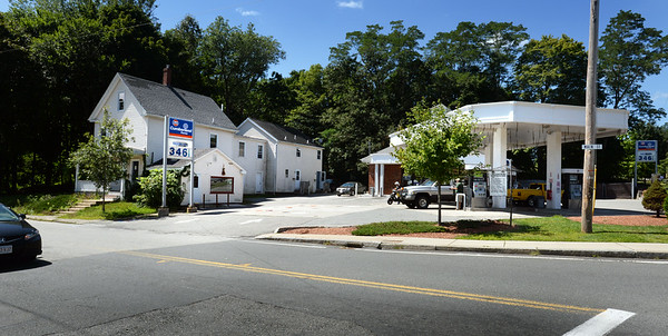 BRYAN EATON/ Staff Photo. The Cumberland Farms at the corner of Haverhill Road and Main Street in Amesbury will be razed, along with the house at left, and a larger store built on the site.