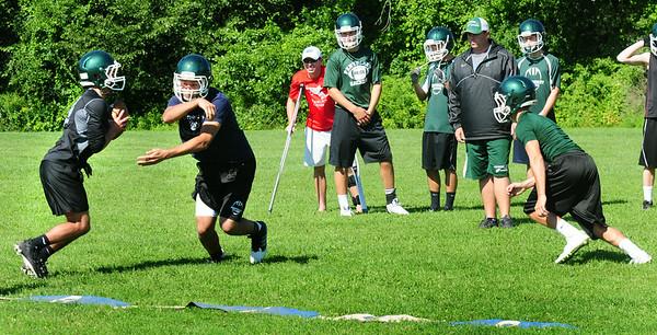 BRYAN EATON/Staff Photo. Pentucket High football defensive back practice yesterday morning.