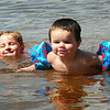 BRYAN EATON/ Staff Photo. Shailyn Donovan, 4, of Amesbury, left, and Aiden DeAlmeida, 23 months, of Ipswich plug along at Lake Gardner Beach in Amesbury. The cousins were there with their mothers who were teaching them how to swim.