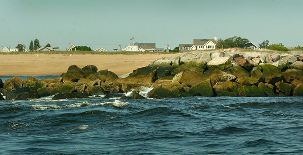BRYAN EATON/ Staff Photo. The end of the south jetty of the Merrimack River with the beach at Plum Island seen in a view from the ocean.