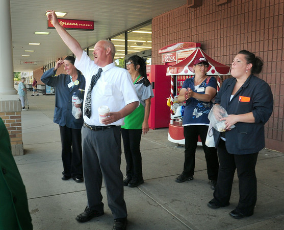 BRYAN EATON/ Staff Photo. Workers at the Newburyport Market Basket respond to customers beeping their horns as they pulled into the parking lot.