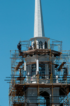 JIM VAIKNORAS/Staff photo  Work continues on the First Religious Society steeple on Pleasent Street in Newburyport.
