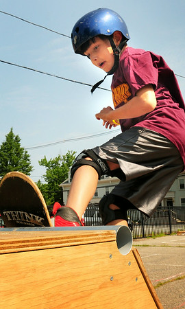 BRYAN EATON/ Staff Photo. Daniel Kolman, 9, practices his skateboarding skills at the Kelley School Playground on Thursday morning. He was taking the skateboard camp held by the Newburyport Department of Youth Services.