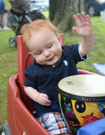 JIM VAIKNORAS/Staff photo Bayne Desmond, 1, plays the a drum provided by Music Together at Family Day at Maudslay in Newburyport Saturday.