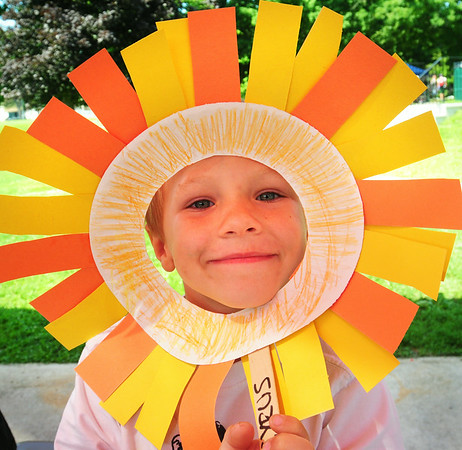 BRYAN EATON/ Staff Photo. Cyrus Nikis, 4, shows off his artwork in the Lion and Sushine project he being the lion. He was in the preschool Summer Camp at Amesbury Town Park run by the town's recreation department.