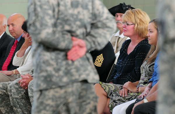 BRYAN EATON/ Staff Photo. Jordan Shay's mother, Holly, right, with Kelsey Chandonnet, who was engaged to the soldier killed in Iraq in 2009, listen to Major General L. Scott Rice describe the Amesbury native during a presentation at the Newburyport Armory of the Massachusetts Medal of Liberty to his family.
